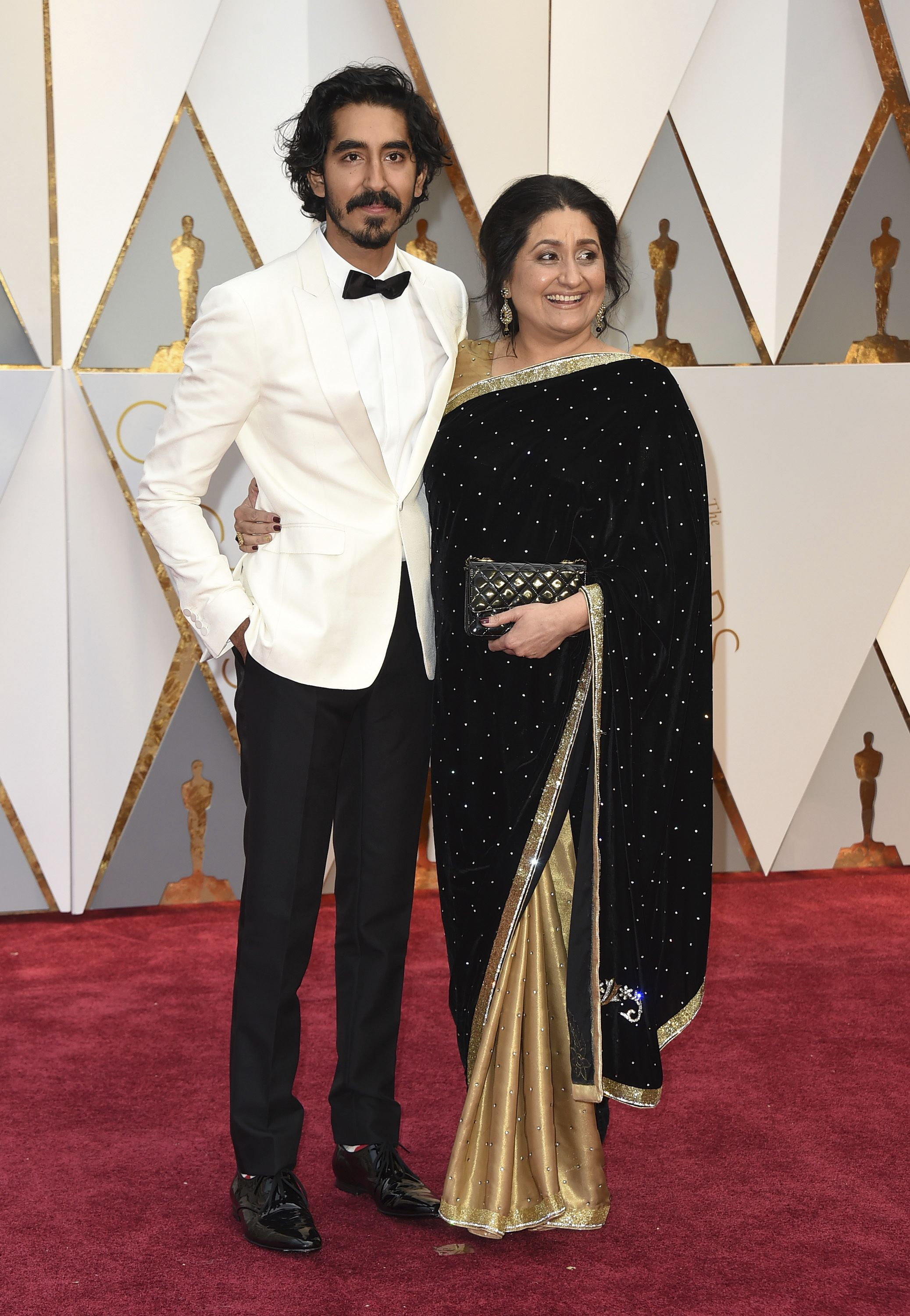 Dev Patel, left, and Anita Patel arrive at the Oscars on Sunday, Feb. 26, 2017, at the Dolby Theatre in Los Angeles. (Photo by Jordan Strauss/Invision/AP)