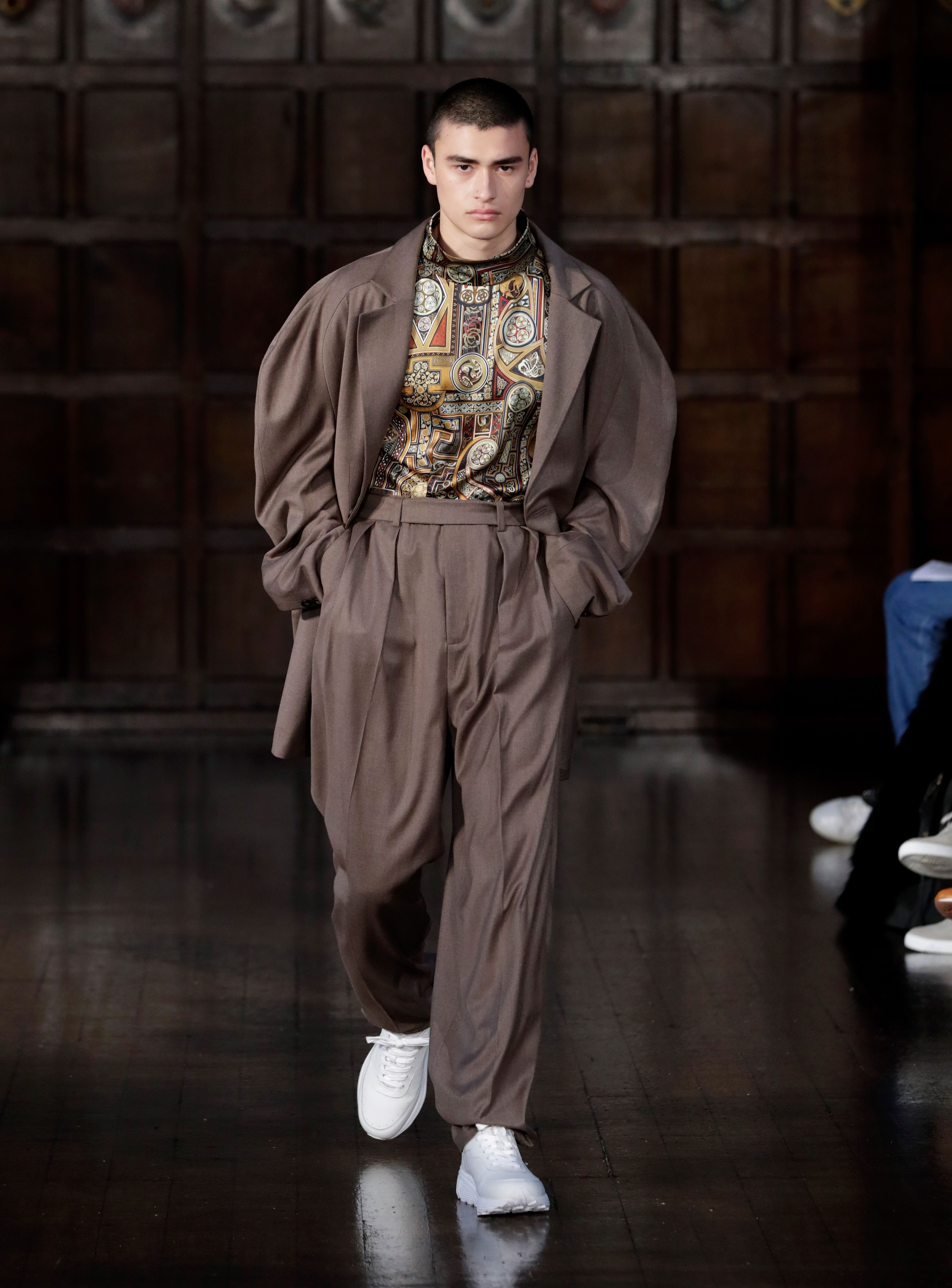 A model walks the runway at the Edward Crutchley show during London Fashion Week Men's January 2018 at the Ironmongers Hall on January 6, 2018 in London, England.